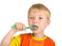 мальчик очищает зубы Стоковое Изображение RF