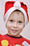 мальчик поздравляет шлем меньший s santa носит Стоковое Фото