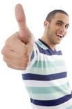 мальчик показывая большие пальцы руки поднимает детенышей Стоковые Изображения
