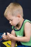 мальчик предпосылки черный немногая играя Стоковая Фотография RF