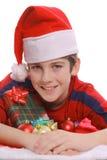 мальчик представляет santa Стоковые Изображения