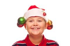 Мальчик рождества с шлемом santa Стоковое Изображение