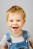 мальчик смеясь над немного стоковые фотографии rf