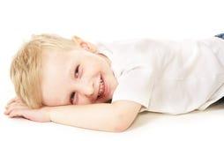 мальчик смеясь над немного Стоковое Изображение