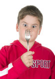 мальчик смотрит штепсельную вилку Стоковое Изображение RF