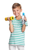 Мальчик с гантелями Стоковое Изображение
