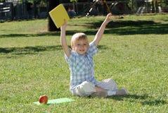 Мальчик с книгами Стоковые Фотографии RF