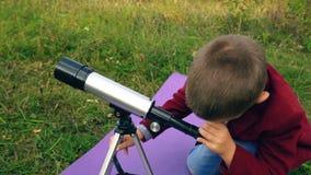 Мальчик с телескопом в природе видеоматериал