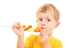 Мальчик с lollipop стоковое изображение