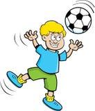 Мальчик шаржа играя футбол Стоковое Изображение RF