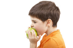 мальчик яблока ест Стоковые Фотографии RF