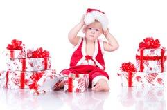 Мальчик Santa Claus с подарками рождества Стоковые Фото