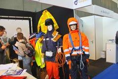 Манекены в welders и слесарь-монтажниках одежды на выставке  Стоковые Фотографии RF