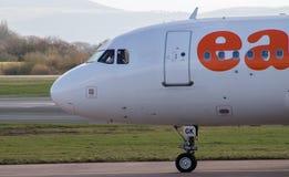 Манчестер, Великобритания - 16-ое февраля 2014: аэробус a easyJet Стоковые Фотографии RF