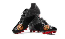 Манчестер Юнайтед FC - ботинки футбола Стоковое Фото