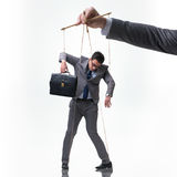 Марионетка бизнесмена изолированная на белой предпосылке Стоковые Фотографии RF