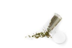 Марихуана в бутылке медицины на белой предпосылке Стоковые Изображения