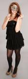 Маска партии молодой женщины нося Стоковое Изображение RF