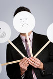 Маскировка: Бизнесмен пряча за разнообразием маск Стоковые Изображения