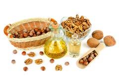 Масло грецкого ореха и фундука, плодоовощ гайки изолированного на белизне Стоковые Изображения RF