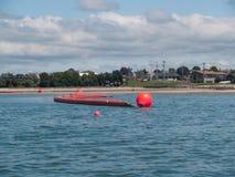 масло tauranga заграждения пляжа inflatible к Стоковое фото RF