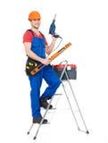 Мастер с инструментами и лестницами Стоковое Изображение