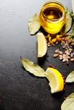 Масло и лимоны Стоковая Фотография