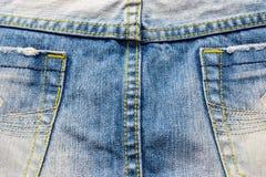 материал голубых джинсов разделяет текстуру Стоковое Изображение RF