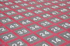 Матрица на асфальте с белыми номерами и красными линиями Стоковые Изображения RF