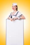 Матрос женщины с пустой доской Стоковое фото RF