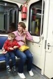 Мать и сын в метро стоковые фото