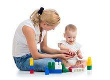 Мать с игрой сына Стоковые Изображения