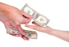 Мать давая деньги ребенка Стоковая Фотография RF