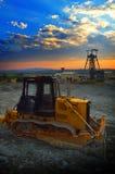 Машина движенца земли на восходе солнца Стоковые Фото