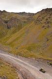 Машина конструкции в горах Стоковое Изображение