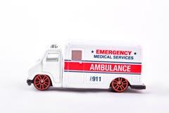 Машина скорой помощи игрушки непредвиденная, белая предпосылка Стоковое Изображение