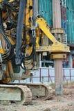 Машина снаряжения кучи скважины в строительной площадке Стоковые Изображения