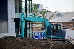 Машинное оборудование Backhoe на строительной площадке стоковое изображение