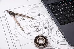 машиностроение частей с инструментами, компьтер-книжка стоковые изображения rf