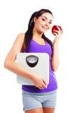 маштабы девушки яблока Стоковые Фотографии RF