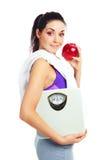 маштабы девушки яблока Стоковая Фотография