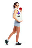 маштабы девушки яблока Стоковое Фото