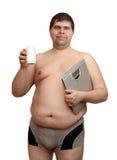маштабы избыточного веса medicaments человека Стоковое Фото