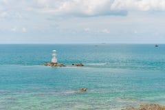 Маяк в голубом море Стоковые Фотографии RF