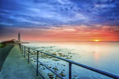 Маяк на восходе солнца Стоковые Изображения RF