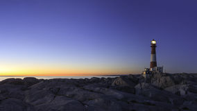 Маяк на заходе солнца Стоковые Фотографии RF