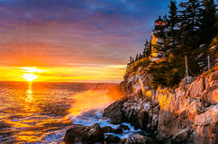 Маяк на заходе солнца стоковое фото rf