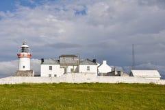 Маяк на скалах головки петли (Ирландия) Стоковые Изображения RF