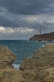 Маяк на скале Стоковая Фотография