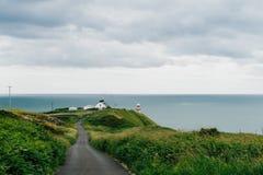Маяк на унылый день, Howth Baily, Ирландия Стоковые Изображения RF
